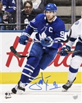 "John Tavares, Signed 8x10 Unframed Maple Leafs Action with ""C"""