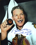 Bobby Hull, Signed 8x10 Unframed Blackhawks White Hold Puck in Locker - 50 Goals